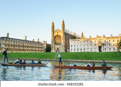 CAMBRIDGE, ENGLAND - JULY 3, 2016. Students punting in Clare College in Cambridge, UK