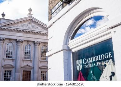 Cambridge, England - October 2018: Cambridge University Press bookshop shop window exterior in Cambridge city centre with Senate House in the background.
