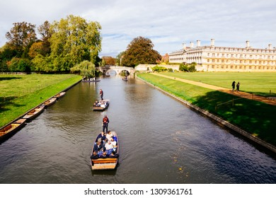 CAMBRIDGE, ENGLAND - SEPTEMBER 21, 2018: Punting on the River Cam at Clare College, University of Cambridge.