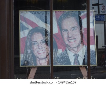 Cambridge, England / UK - February 2, 2012: a portrait of William & Kate Middleton, Duke and Duchess of Cambridge and the Union Jack made of colourful sweets, in the window of a shop in Cambridge