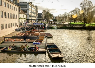CAMBRIDGE, England, United Kingdom - December 2015. Romantic punts on Cam river in Cambridge at sunset