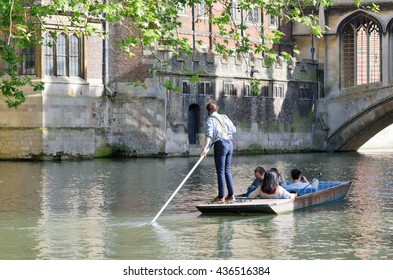 Cambridge England, United Kingdom -May 20, 2016: Punter in braces guiding  tourists on Cam Cambridge England