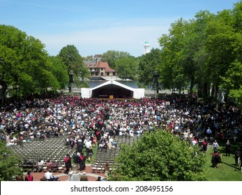 CAMBRIDGE, MA - MAY 29: People sit in chairs as Harvard Business Students of Harvard University gather for their graduation ceremony on Commencement Day on May 29, 2014 in Cambridge, MA.