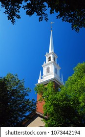 Cambridge, MA, USA August 11 The spire of the Memorial Church is framed by trees in Harvard Yard on the University's campus in Cambridge, Massachusetts