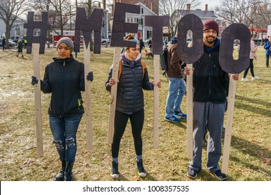 Cambridge, MA, USA – January 20, 2018. Thousands rally in Cambridge Common marking the first anniversary of the Women's March  Protesters displayed anti-Trump signs and wore pink hats that have become