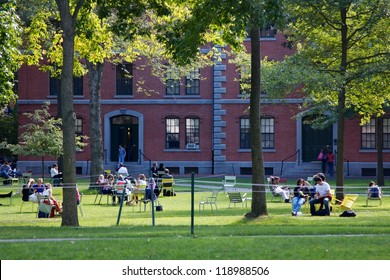 CAMBRIDGE, MA, USA - SEPTEMBER 27: Students and tourists rest in lawn chairs in Harvard Yard, the open old heart of Harvard University campus on September 27, 2012 in Cambridge, MA, USA.