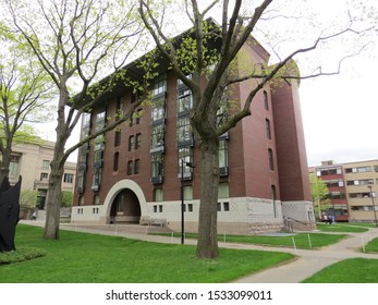 CAMBRIDGE, MASSACHUSETTS - MAY 12, 2016: A view of the Harvard University Campus on an overcast day. Harvard University was established in 1636 and it is the oldest university in the United States.