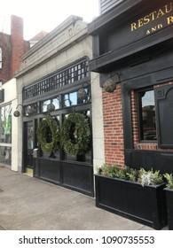 Cambridge, Massachusetts / United States - December 17, 2017: Festive decorations brighten a city sidewalk