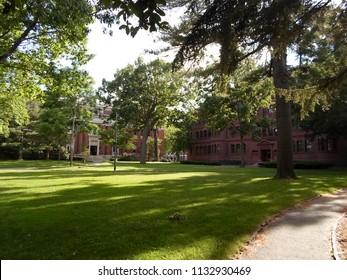 Cambridge, Massachusetts / USA - July 12 2018: Emerson Hall (left) and Sever Hall (right) inside Harvard Yard at Harvard University