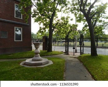 Cambridge, Massachusetts / USA - July 17 2018: Lionel Hall, Sundial, and 1870 Gate, Harvard Yard, Harvard University