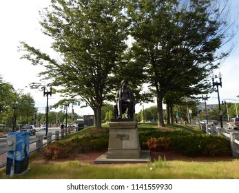 Cambridge, Massachusetts / USA - July 24 2018: Statue of Charles Sumner outside Harvard Yard in Harvard Square