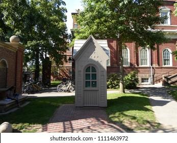 "Cambridge, Massachusetts / USA - June 12 2018:""Gatelodge"" guardhouse at the Johnston Gate of Harvard Yard, Harvard University"
