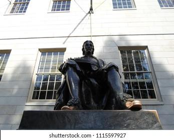 Cambridge, Massachusetts / USA - June 18 2018: Bronze statue of John Harvard inside Harvard Yard, Harvard University