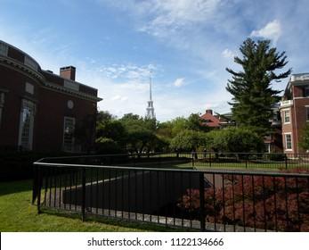 Cambridge, Massachusetts / USA - June 27 2018: Houghton Library (left) and Loeb House (right) inside Harvard Yard of Harvard University