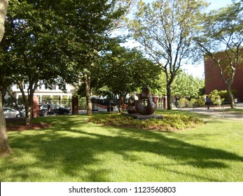 Cambridge, Massachusetts / USA - June 29 2018: 'Large Four Piece Reclining Figure' bronze sculpture by Henry Moore located outside Lamont Library in Harvard Yard of Harvard University