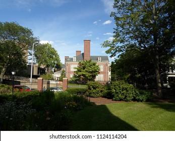 Cambridge, Massachusetts / USA - June 30 2018: Harvard Faculty Club seen from Harvard Yard near Lamont Library of Harvard University. Also visible is the Carpenter Center for Visual Arts (left)