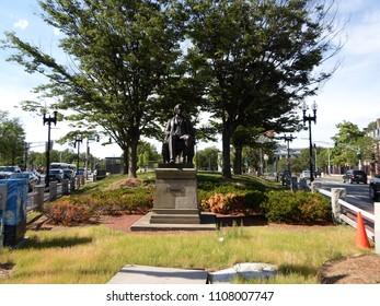 Cambridge, Massachusetts / USA - June 7 2018: Charles Sumner Statue, Harvard Square