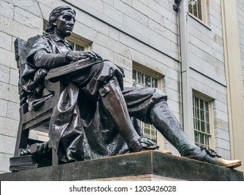 Cambridge, Massachusetts, USA, September 25, 2018. Harvard University, sculpture of John Harvard, in the center of Harvard Yard, the oldest area of the campus.