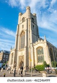 CAMBRIDGE - MAY 23: Church of Saint Mary the Great, Gothic architecture building in Cambridge, England, under cloudy blue sky, on May 23, 2016.