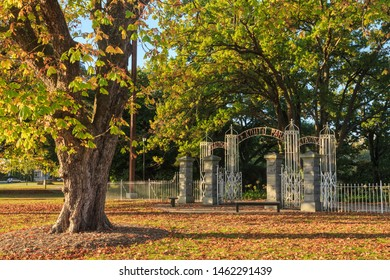 Cambridge / New Zealand - May 4 2019: The Gates of Te Koutu Park, Erected in 1911, Surrounded by Autumn Foliage