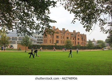 Cambridge - October 3: people play on the lawn in a park, on October 3, 2015, Cambridge, UK.
