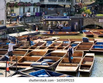 CAMBRIDGE, UK - 08/11/2017:  Scudamores Punting Company Punts being prepared for hire at Mill Lane Punting Station