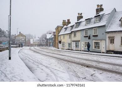 Cambridge, UK -  10 December 2017. UK Weather: Heavy snow in Cambridge, England,  UK with empty road covered in white snow.