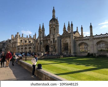 Cambridge, UK - 21 May 2018: Kings College on a sunny day with tourist and student walking