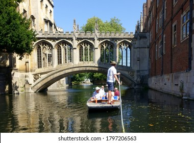 Cambridge, UK 31 July 2020: Punting along the backs of the colleges on the river Cam in Cambridge