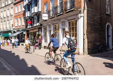 Cambridge, UK -April 2018. Young students cycling in Trinity street, central Cambridge, UK