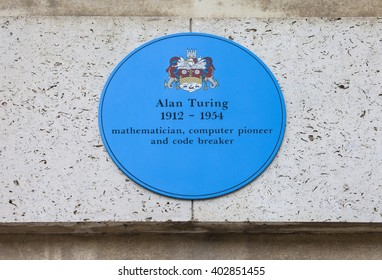 CAMBRIDGE, UK - APRIL 8TH 2016: A blue plaque at Kings College in Cambridge commemorating former student and computer pioneer Alan Turing, taken on 8th April 2016.