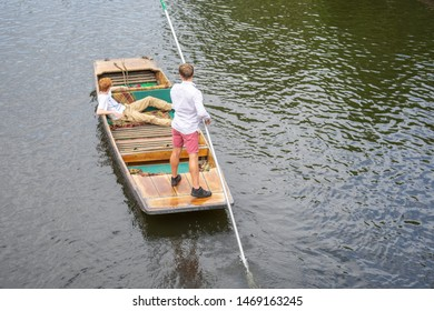 Cambridge, UK, August 1, 2019. The punter pushes a pole against the river bed and this gives the punt a way to move