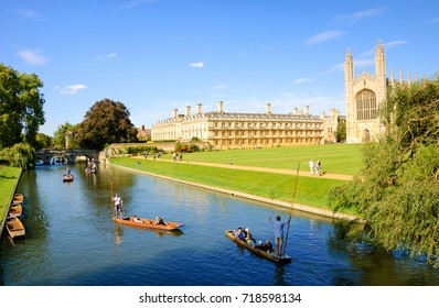 CAMBRIDGE, UK  - AUGUST 16, 2017: Tourists enjoy punting at The Backs of colleges along the River Cam banks in Cambridge. King's College buildings and chapel at background.