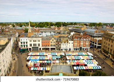 CAMBRIDGE, UK  - AUGUST 16, 2017:  View of colorful market stalls at historic market square of Cambridge.