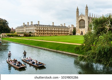 Cambridge, UK -August 2017. King's College and King's College Chapel view from The Backs with the River Cam passing through and 2 punting boats with tourists doing a guided tour