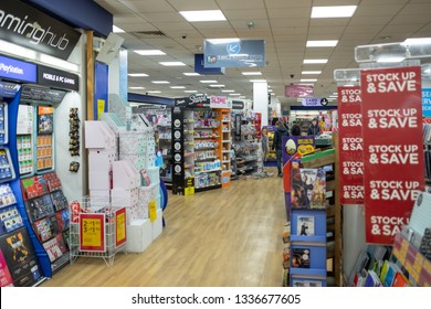 Cambridge, UK - Circa March 2019: Shallow focus of Sales Banners seen within a well-known book store and stationary seller. Various items, books and gift cards are shown in display near the tills.