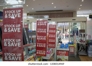 Cambridge, UK - Circa March 2019: Shallow focus of Sales Banners seen within a well-known book store and stationary seller. Various items, books and gift cards are shown in display near the front.