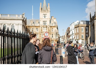 Cambridge, Uk - Circa March 2019:  Group of Cambridge students seen during a peaceful protest outside the famous Kings College. The background shows the fine architecture  of the old university city.