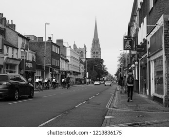 CAMBRIDGE, UK - CIRCA OCTOBER 2018: People in the city centre in black and white