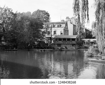 CAMBRIDGE, UK - CIRCA OCTOBER 2018: Punting on River Cam in black and white