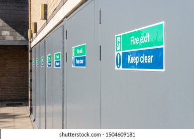 Cambridge, UK - Circa September 2019: Abstract view of Fire Exit doors seen at the rear of a shopping arcade. The multiple doors are used for customers to escape during an emergency from the arcade.