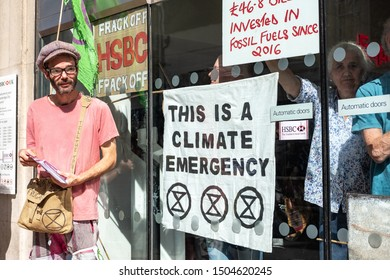 Cambridge, UK - Circa September 2019: Protestors, part of Extinction Rebellion seen having taken over a popular, UK high street bank. Some of the protestors have locked them inside the bank.