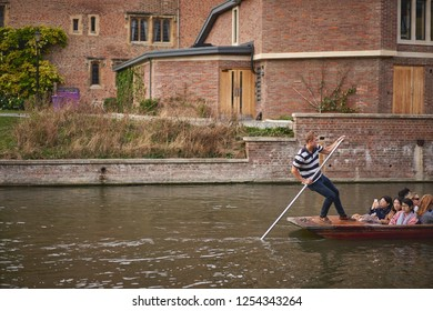 Cambridge. UK - December, 2018. Punt boats on the river Cam. Punting is very popular in Cambridge for sightseeing colleges.