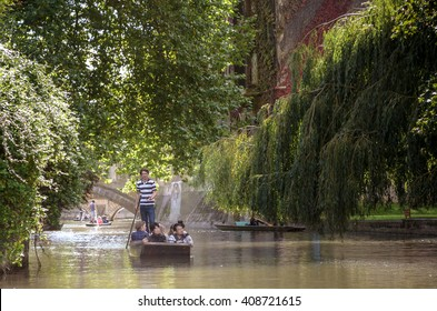 CAMBRIDGE, UK - JULY 22, 2015: Punting in summer on the river Cam. There are several companies on the Cam operating tours and hiring punts to visitors.