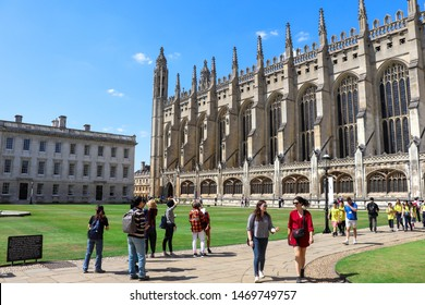 Cambridge, UK – July 29th, 2019: Tourists and visitors look around King's College in Cambridge. King's College has over 31,000 students.