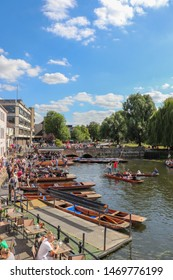 Cambridge, UK - July 29th 2019: Punters in river near King's College chapel in Cambridge.  Punts are used for pleasure trips on the rivers in university towns.