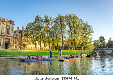 Cambridge, UK; November 2018; Tourists on punt trip (sightseeing with boat) along River Cam near Kings College in the city of Cambridge, United Kingdom