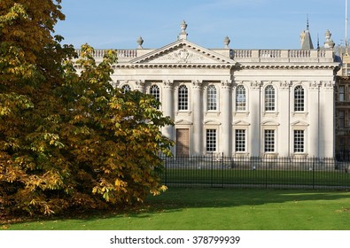 CAMBRIDGE, UK - OCTOBER 31 2015: An autumn-leaved horse chestnut tree obscures part of the Senate House, a historic university building in the center of Cambridge, England.