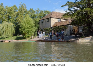 CAMBRIDGE, UK - SEPTEMBER 16, 2018: Tourists at Trinity College Punt House hiring punt boats