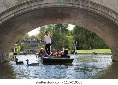CAMBRIDGE, UK - SEPTEMBER 16, 2018: Punt boat tour about to pass through The Avenue Bridge next to Trinity College, Cambridge, England